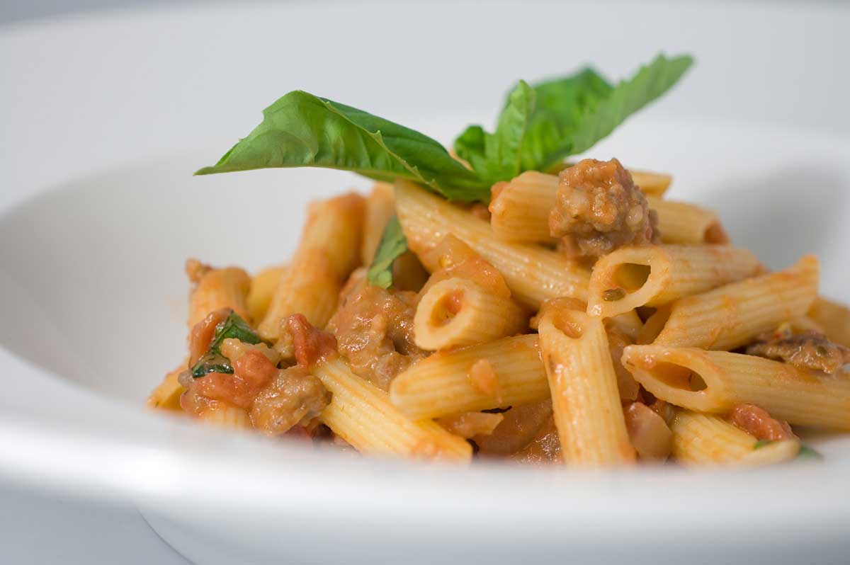 Recipe for creamy tomato penne with italian sausage life for American continental cuisine