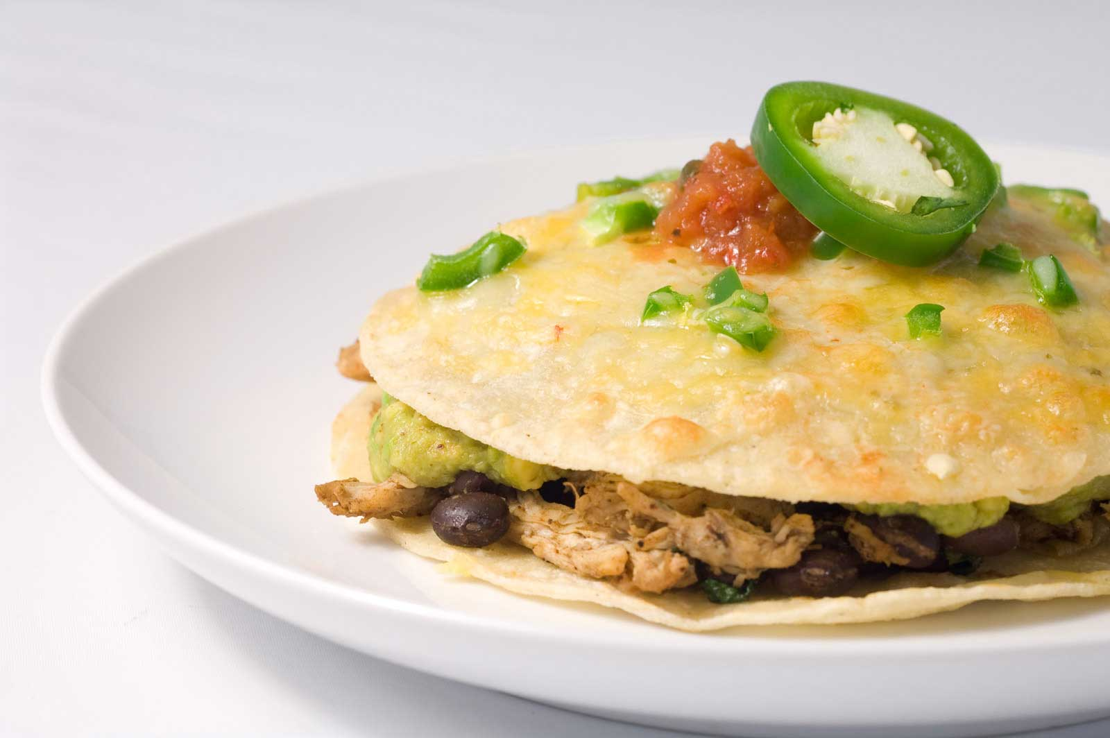 Mexican tortilla stack with chicken and beans mexican for Mexican food